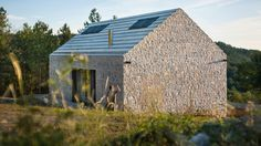 Compact Karst House looks like the locals from the outside, totally modern inside: exterior showing stone walls