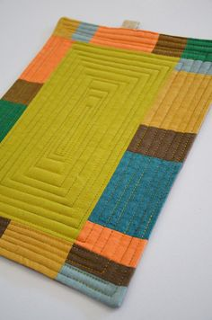 Colorful Patchwork Mug rug--I like the quilting, looks cool and very simple to do.