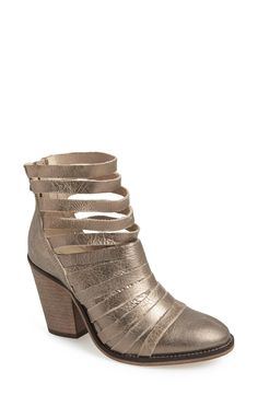 Always get compliments when wearing these gold Free People strappy booties.