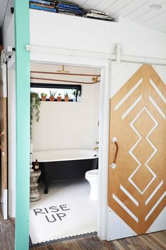 In 560 Square Feet, the Colorful Home of Small Space Dreams Tiny House Movement // Tiny Living // Tiny House on Wheels // Tiny House Bathroom // Tiny Home Barn Door // Tiny Home // Architecture // Home Decor Tiny Bathrooms, Small Bathroom, Master Bathroom, Master Closet, Modern Bathroom, Boho Bathroom, Bathroom Ideas, Bathroom Inspiration, Bathroom Green
