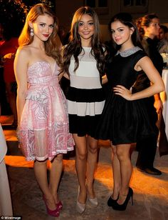 Actresses (from left to right) Holland Roden, from Teen Wolf, Sarah Hyland, from Modern Family, and her co-star Ariel Winter cosy-up a the ELLE And Miss Me Party