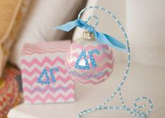 Delta Gamma Ornaments are a must have for any sorority girl! Decorate your Christmas tree at home, at school and at work. Give as gift to daughter or a new sister. Each ornament is perfectly packaged with a matching gift box and coordinating tied ribbon at the top of the ornament for easy gift giving and safe storage. Ornaments are glass and are packaged very carefully when shipped to prevent breakage.