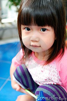 Beautiful chinese child by Amot, via Dreamstime
