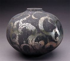 Harvey Sadow presents the most traditional vessels on display, smoothly rounded forms with but small openings at their tops. Loose, Eastern brush marks decorate their outer surfaces. While at first glance they appear somewhat earthy, moving around them reveals a surprising amount of color. Sadow describes the work as looking for calm and balance, and these are that - stoic yet playful, quiet yet quite active. Through the combination of the marking and color, the solid forms almost take…