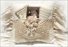 Vintage Pocket Pillow Lace Rose - 45.00  ~ This is a handmade pocket pillow with a 6 inch ruffle ~  A vintage photo and  piece of sheet music are tucked   in the pocket ~  The pocket is embellished with  a handmade lace and muslin rose~  It measures16 x 16 inches  not including the ruffle ~  The back has an invisible zipper   so the pillow form is removable ~  ~ Spot clean only ~ http://www.katiesrosecottagedesigns.com