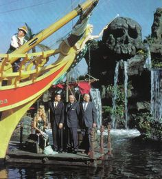 Walt Disney in front of Skull Rock celebrating the opening of the Tuna Boat in Disneyland. (This page also has other fun vintage Disneyland pictures)