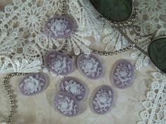 These beautiful cameos are great for anyone interested in jewelry making, scrapbooking, card making, making mini albums, and many other crafts.They can be used as an accent on a scrapbook page, as a flower center, be hung as a charm, or would create a beautiful necklace pendant.Quantity: 8 cameosMeasurements: 18mm x 25mmShipping Weight: 9gShipping costs are calculated based on a total shipping weight of less than 500g, otherwise additional shipping charges may apply.  Allow an additional 15g…