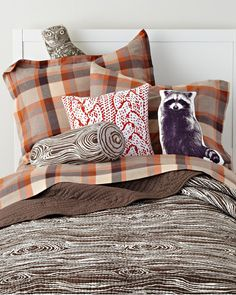 plaid bedding with birch bark prints and sweater cable stitch pillow pattern---wonderful combo
