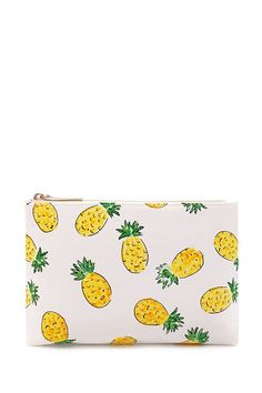 A canvas makeup bag with an allover pineapple print and a zipper top closure.