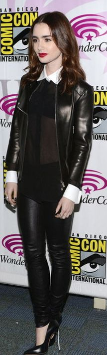 Who made Lily Collins black leather jacket, collar top, and black pumps?
