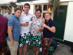 A group of fantastically dressed gentlemen enjoying a 'quiet' pint at Pub Golf. Paddy Par! Shorts & Ka-Boom Golf Trousers are sure to make an impact - nice choice guys.