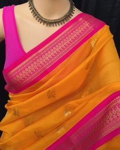 Mango yellow Kora cotton saree with contrast pink zari border. Comes with contrast pink blouse piece. Cotton Saree Designs, Saree Blouse Neck Designs, Saree Blouse Patterns, Cotton Saree Blouse, Kora Silk Sarees, Silk Cotton Sarees, Saree Jewellery, Simple Sarees, Saree Trends