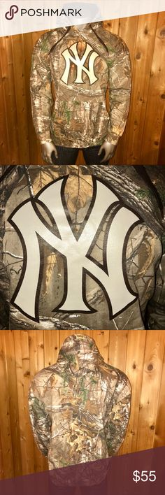 NWT! Realtree MLB New York Yankees Camo Hoodie Brand New With Tags!  Size: U.S. Men's XL Color: Camouflage Brand: REALTREE Xtra & Stitches Official MLB and New York Yankees Genuine Licenced Baseball Apparel/Merchandise Regular Fit 80% Cotton, 20% Polyester Made in Pakistan  Perfect for Hunting Season, Running, and the Fall/Winter Seasons  Hoodie comes from a smoke and pet free home  Thanks for looking! Realtree Shirts Sweatshirts & Hoodies