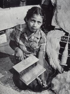 Navajo girl carding wool