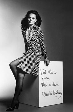 Diane von Furstenberg wearing the shirt wrap dress in navy and white geometric print, pearls, Bulgari snake watch and heels photographed by Roger Prigent, 1974 for Women Wear Daily ad campaign