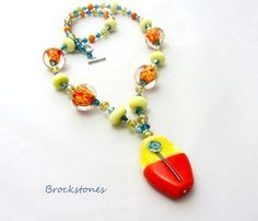 The lovely lampwork beads in this necklace are in shades of orange, red, lemon and yellow. The focal bead features a stylised flower in turquoise. I have also used champagne coloured button crystals and turquoise bicone crystals. Handmade Necklaces, Handmade Items, Handmade Gifts, Diy Crafts For Gifts, Champagne Color, Beautiful Gifts, Glass Necklace, Orange, Yellow