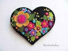 multi flower black heart pin