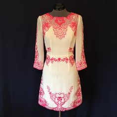 ASOS Placement Embroidered Shift Dress STUNNING!! GORGEOUS EMBROIDERY!! All embroidery is completely intact. White polyester body with bright pink embroidery. Sewn in lining. The back is an open design with 3 button closure, with an invisible zipper on the skirt up to the waist center back. Size 0, TTS. Back of neck to hem is 32 inches. Set in waist measured flat is 24 inches....that's your true waist, the skinniest part of your abdomen. In PERFECT CONDITION!! ASOS Dresses
