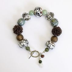 Sage Lampwork Bracelet by ClassyGemsByCarol on Etsy. Pre-Holiday sale. All items now 25% off. See my shop for details.