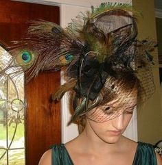 DIY fascinator. LOVE the peacock feathers!