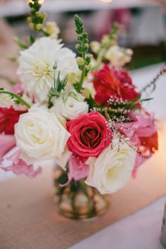 #Centerpiece | #Coral | Photography: Majesta Patterson | See More on #SMP Weddings: http://www.stylemepretty.com/2013/12/06/big-sur-wedding-from-majesta-patterson/