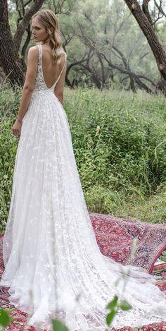 Romantic embellished v-shaped back design A-line wedding dress; Featured Dress: Limor Rosen