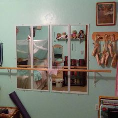 Easy and inexpensive ballet barre... mirrors, handrail, and shelf brackets about $50 at Lowe's. Pre-cut wooden plaque and miscellaneous knobs make for great point-shoe storage (allowing shoes to air-out between classes).