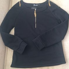 Top Gold zippered, has the feel and thickness of a sweatshirt, never worn with tag Tops Sweatshirts & Hoodies
