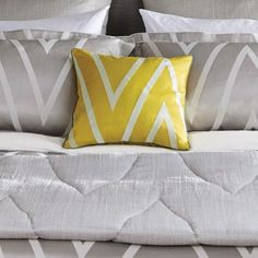 Moriko Embroidered Cushion (57430) - Harlequin Cushions - A bright, yellow embroidered cushion with a large, white chevron print- perfect for adding a splash of colour to a contemporary interior and works well with the Moriko bedding and throw. This cushion will also work well within a more traditional styled space. Cushion size: 40x40cm.