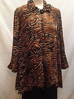 Gorgeous and chic, this animal print tunic will make you feel glamorous in a wild way! - Berek - Animal print tunic with button closure at neck - #Casanovasdownfall #AnimalPrint #Ootd #FashionInspo #WinterFashion #Chic #GlamorousStyle