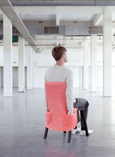 Dutch designers Bernotat & Co have created a range of coverings for chairs that are modelled on a grandma's dressing gown, baggy overalls and an oven mitt.