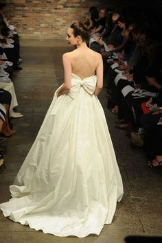 Accent your wedding dress with a bow. After all, you are a gift to your significant other. #weddingdress