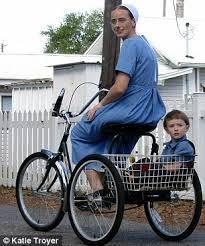 Who said that wearing  a modest dress will prohibit one from riding a bicycle?