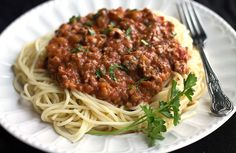 This fast-track recipe for Quick & Easy Spaghetti Bolognese meat sauce is bursting with flavor and cooks in just 30 minutes!