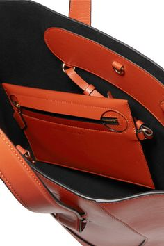 Burnt-orange leather (Calf) Clasp fastening at open top Designer color: Terracota Weighs approximately 1.5lbs/ 0.7kg Made in Italy