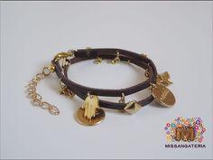 http://www.elo7.com.br/pulseira-wrap-couro-marrom-c-pingentes/dp/2588D0b    Pulseira de enrolar, em couro marrome pingentes diversos dourados R$35,00