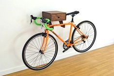 Bikes Discover The Clifton Bike Rack - Stylish wall mount indoor bike shelf in walnut with drawer for accessories and bike gear.