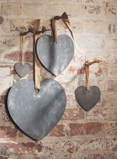 heart chalk boards - a little grumpy to see these as I made some of these and gifted them around a year ago, using jig saw cut hearts from MDF, primed then painted them with chalkboard paint with a drilled hole to hang from red ribbon - sweet! Need to make some more!