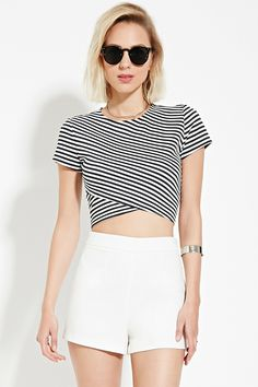 0217210968 A stretch knit crop top featuring allover stripes