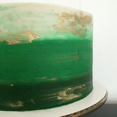 Watercolor green ombré cake with cream and gold accents! Lemon blueberry with lemon curd