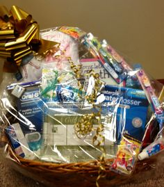 Basket filled with goodies that we contributed to the North Aurora Mothers Club 2014 Winter Gala.  Proud to be a sponsor! #northaurorasmiles