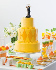 Fun, personal details make old-fashioned bride and groom cake toppers feel new again. We love this one (with the perfect Portland umbrella) that Soiree, Special Event Planning placed atop this bold yellow cake from Jaciva's as part of our desserts feature.
