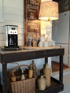 Create a coffee station to de-clutter your kitchen counter.  LOVE the shabby/ chippy table!
