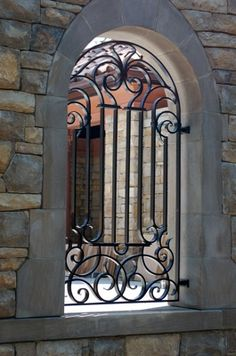 wrought iron - could use old floor grate in wood fence as well