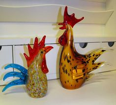 "For the rooster lovers, beautiful art glass roosters. 12"" & 8"""
