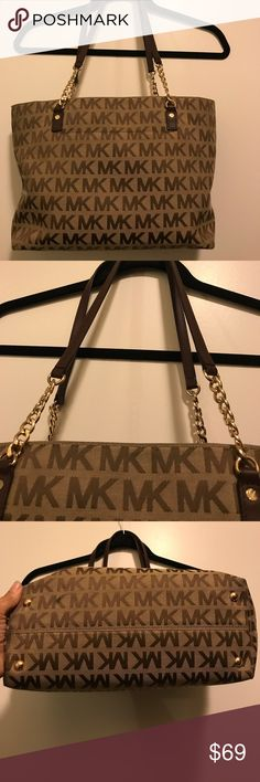 Michael Kors Purse Used but in great condition . Zips close.4 small pockets inside ,, 1 large pocket air zipper.Pocket on outside . Chain handle . Michael Kors Bags Shoulder Bags