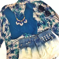 The stores may be closed but you can still shop online 24/7!! Check out this tropical look featuring our new teal crop tank (19.99), ombré studded shorts (29.99) available online and in store at #sophieandtrey, palm tree kaftan (39.99), mystic sapphire necklace (9.99) available online and in store at #4thandocean! #tropical #palmtrees #croptop #beachy #laydown #onlineshopping #friday