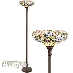 Tiffany Vloerlamp Karalee Uplight Flowers  Een bijzonder mooie vloerlamp met bloemmotief. Helemaal met de hand gemaakt van echt Tiffanyglas. Dit originele glas zorgt voor de warme uitstraling. De voet is bronskleurig. Met 1x grote fitting (E27). Met schakelaar aan het stroomsnoer. Afmetingen: Hoogte: 177 cm Diameter Kap: 36 cm
