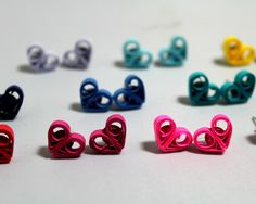 As Chandler would say, could these BE any cuter?!  These adorable little heart stud earrings have been handmade from quilling paper. They are available in many awesome colors but feel free to request another color you don't see here. These studs may be cute as a button but they are also durable and suitable to wear every day. They have been individually hand painted in a sealant which makes them water resistant and UV resistant. They are attached to silver plated posts with plastic safety…