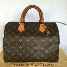 Louis Viitton Speedy 30 Great used condition. The handles got lil dark...inside is very clean free of stain. All four corners are in perfect condition. Brand new zipper tap repaired from Louis Vuitton. The dustbag in the photo not included; comes with lock and two keys. Louis Vuitton Bags Satchels